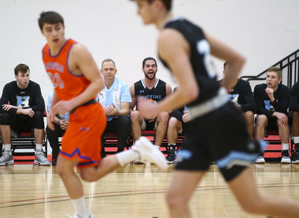Johns Hopkins' Daniel Vila, center, shouts in support of his teammates during the first half of a basketball game against UW-Platteville in the D3Hoops.com Classic at South Point in Las Vegas on F ...