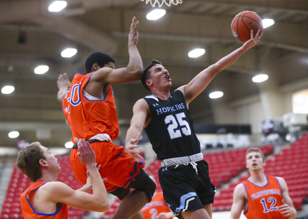 Johns Hopkins' Noah Ralby (25) goes to the basket past UW-Platteville's Justin Stovall (30) during the first half of a basketball game in the D3Hoops.com Classic at South Point in Las Vegas on Fri ...