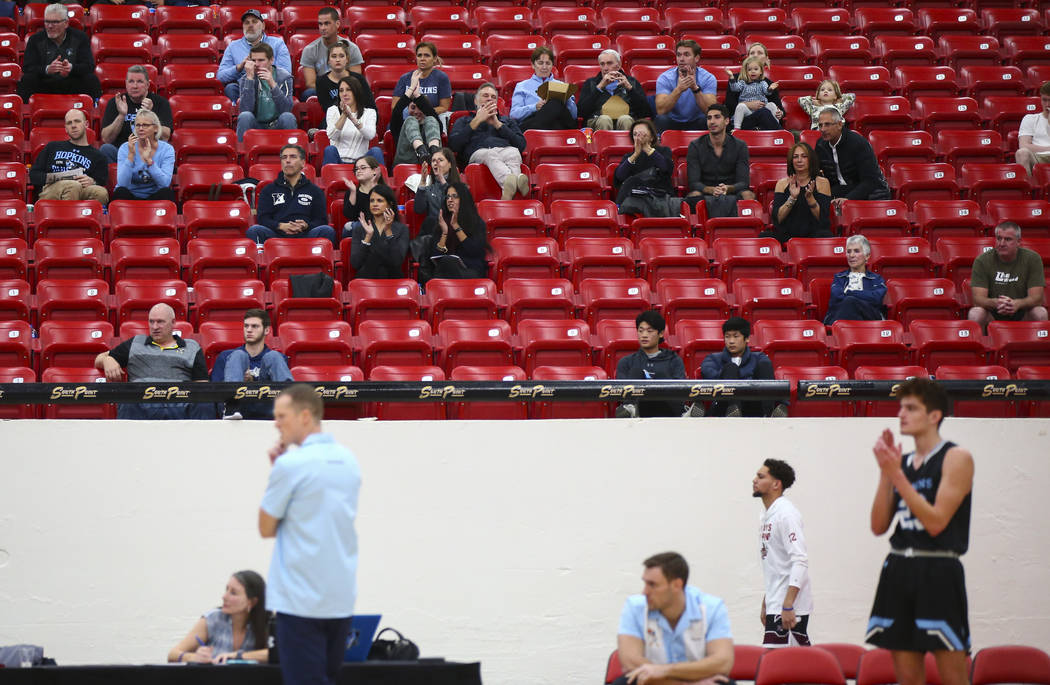 Johns Hopkins fans celebrate as the team leads against UW-Platteville during the first half of a basketball game in the D3Hoops.com Classic at South Point in Las Vegas on Friday, Dec. 28, 2018. Ch ...
