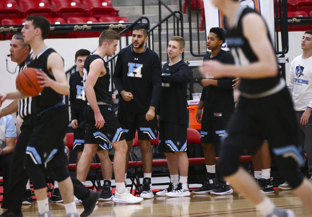 Johns Hopkins' Joey Fitzpatrick, center left, returns to the bench during the first half of a basketball game in the D3Hoops.com Classic against UW-Platteville at South Point in Las Vegas on Frida ...