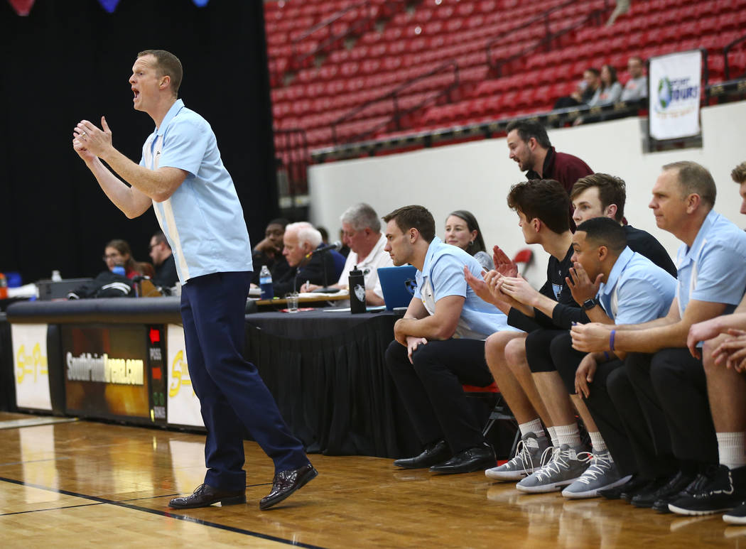 Johns Hopkins coach Josh Loeffler shouts to his team during the first half of a basketball game against UW-Platteville in the D3Hoops.com Classic at South Point in Las Vegas on Friday, Dec. 28, 20 ...