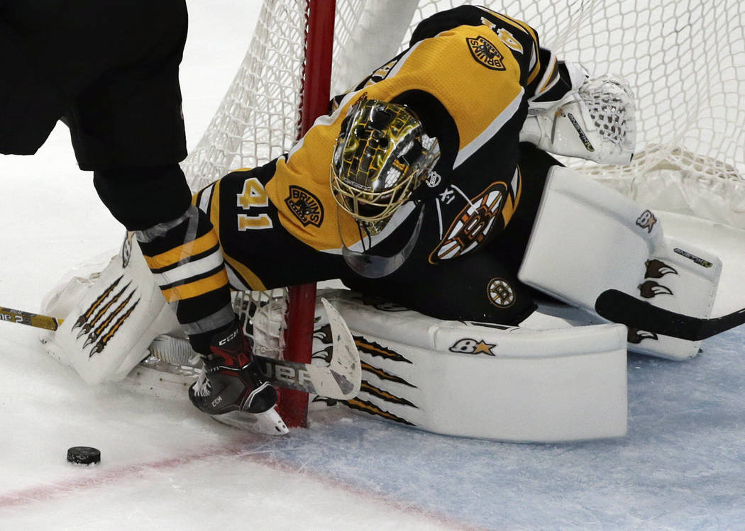 Boston Bruins goaltender Jaroslav Halak (41) keeps his eye on the puck in the third period of an NHL hockey game against the Anaheim Ducks, Thursday, Dec. 20, 2018, in Boston. The Bruins won 3-1. ...