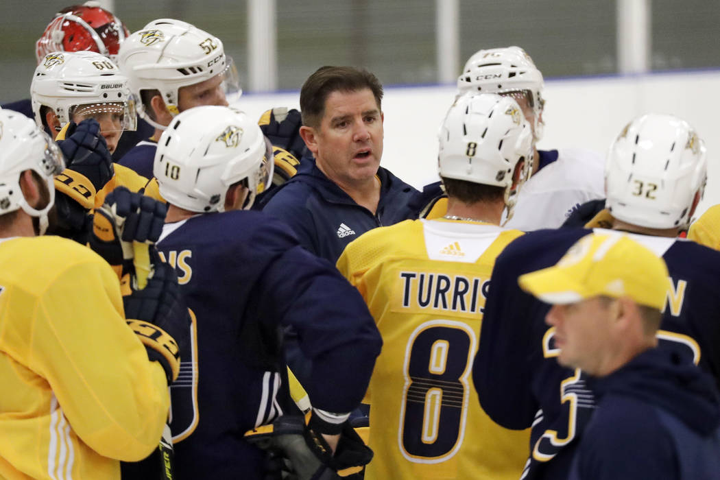 Nashville Predators head coach Peter Laviolette talks to his players during NHL hockey training camp Saturday, Sept. 15, 2018, in Nashville, Tenn. (AP Photo/Mark Humphrey)