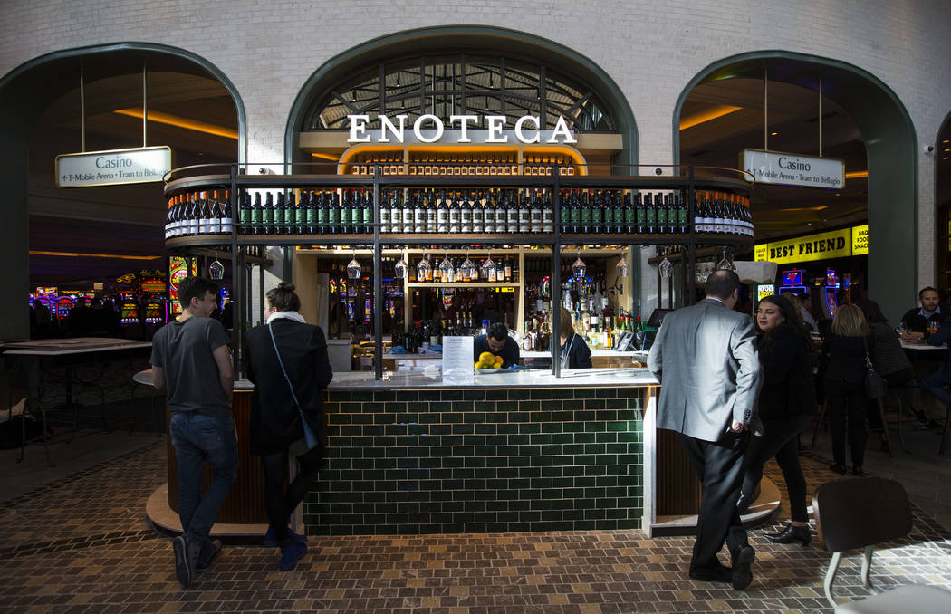 People stop by Enoteca, a wine bar, before the ribbon cutting ceremony for Eataly at Park MGM in Las Vegas on Thursday, Dec. 27, 2018. Chase Stevens Las Vegas Review-Journal @csstevensphoto