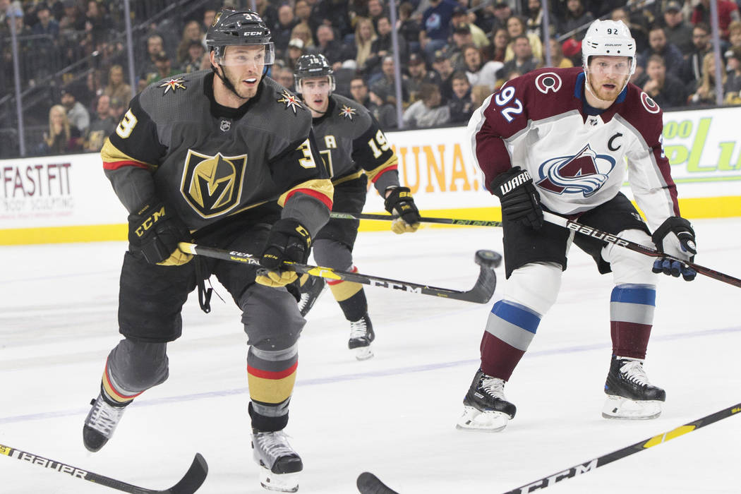 Golden Knights defenseman Brayden McNabb (3) balances the puck on his stick while skating up ice past Colorado Avalanche center Gabriel Landeskog (92) in the first period on Thursday, Dec. 27, 201 ...