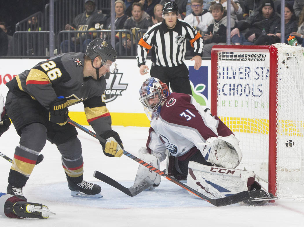 Golden Knights center Paul Stastny (26) scores a first period goal past Colorado Avalanche goaltender Philipp Grubauer (31) on Thursday, Dec. 27, 2018, at T-Mobile Arena, in Las Vegas. Benjamin Ha ...