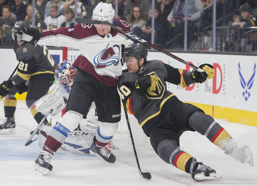 Golden Knights center Ryan Carpenter (40) collides with Colorado Avalanche defenseman Tyson Barrie (4) in the first period on Thursday, Dec. 27, 2018, at T-Mobile Arena, in Las Vegas. Benjamin Hag ...