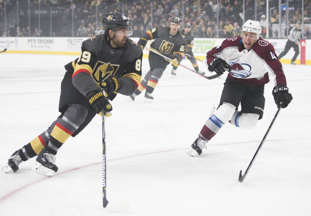 Golden Knights right wing Alex Tuch (89) pushes the puck up ice past Colorado Avalanche defenseman Tyson Barrie (4) in the first period on Thursday, Dec. 27, 2018, at T-Mobile Arena, in Las Vegas. ...