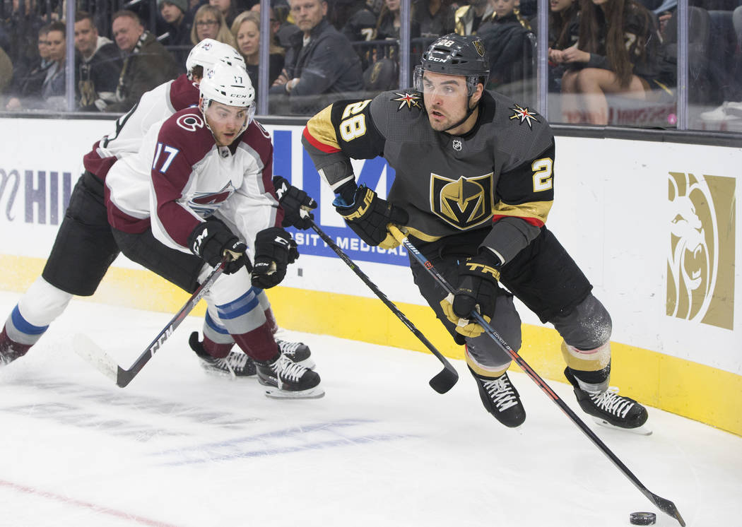 Golden Knights left wing William Carrier (28) skates past Colorado Avalanche center Tyson Jost (17) in the first period on Thursday, Dec. 27, 2018, at T-Mobile Arena, in Las Vegas. Benjamin Hager ...
