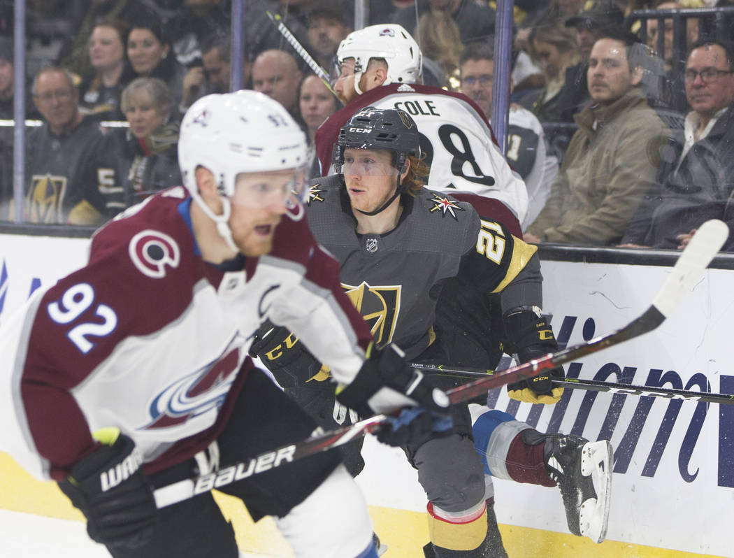 Golden Knights center Cody Eakin (21) gets tied up with Colorado Avalanche defenseman Ian Cole (28) and center Gabriel Landeskog (92 ) in the first period on Thursday, Dec. 27, 2018, at T-Mobile A ...