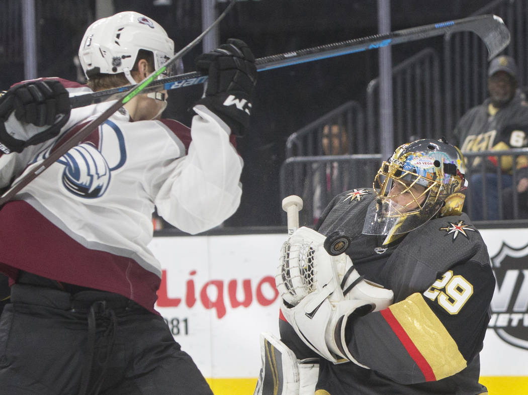 Golden Knights goaltender Marc-Andre Fleury (29) makes a save against Colorado Avalanche center Tyson Jost (17) in the second period on Thursday, Dec. 27, 2018, at T-Mobile Arena, in Las Vegas. Be ...