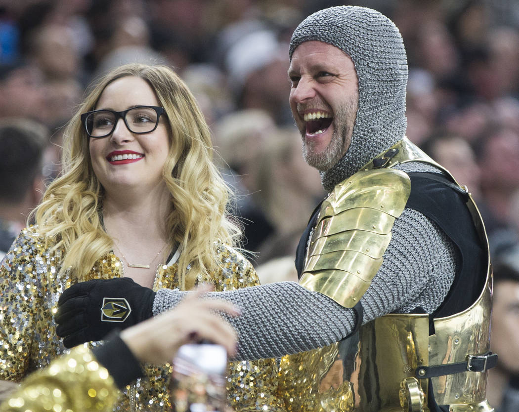 The Golden Knight, aka Lee Orchard, right, interacts with fans in the second period on Thursday, Dec. 27, 2018, at T-Mobile Arena, in Las Vegas. Benjamin Hager Las Vegas Review-Journal