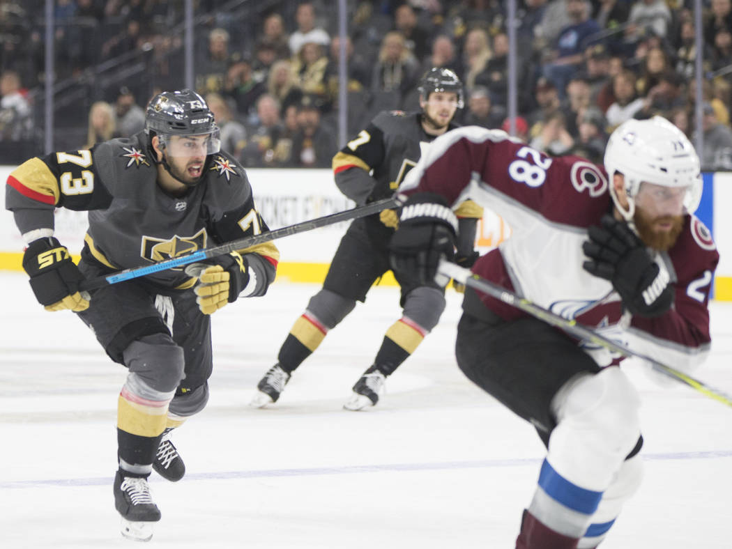 Golden Knights center Brandon Pirri (73) races up ice with Colorado Avalanche defenseman Ian Cole (28) in the third period on Thursday, Dec. 27, 2018, at T-Mobile Arena, in Las Vegas. Benjamin Hag ...