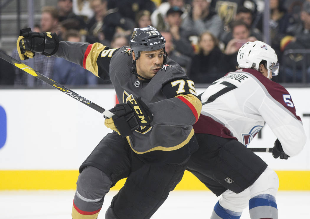 Golden Knights right wing Ryan Reaves (75) fights for position with Colorado Avalanche left wing Gabriel Bourque (57) in the third period on Thursday, Dec. 27, 2018, at T-Mobile Arena, in Las Vega ...