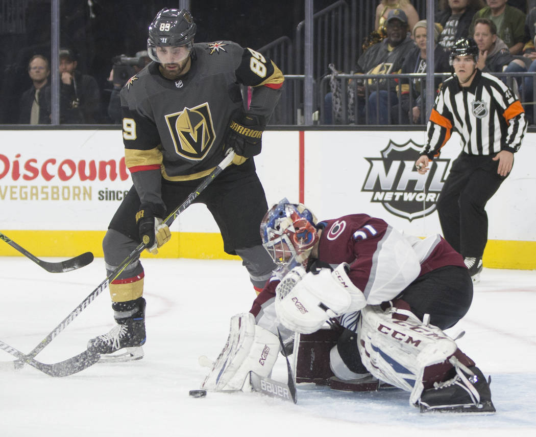 Colorado Avalanche goaltender Philipp Grubauer (31) makes a save against Golden Knights right wing Alex Tuch (89) in the third period on Thursday, Dec. 27, 2018, at T-Mobile Arena, in Las Vegas. B ...