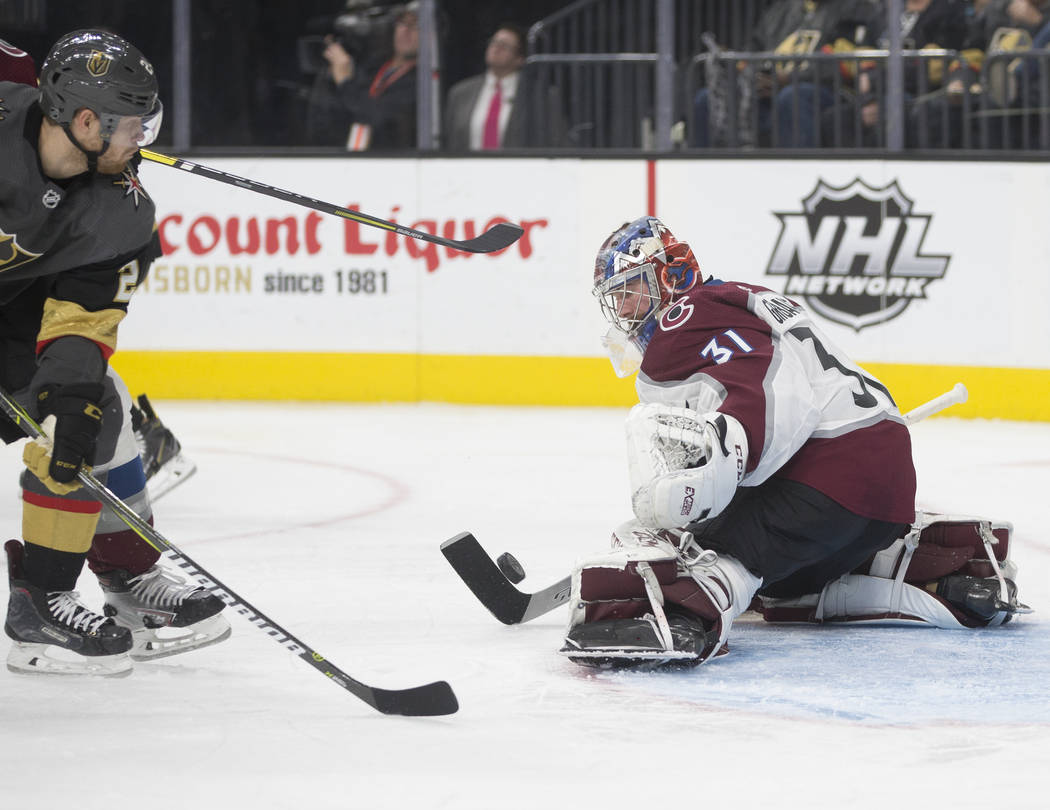 Colorado Avalanche goaltender Philipp Grubauer (31) makes a save against Golden Knights center Paul Stastny (26) in the third period on Thursday, Dec. 27, 2018, at T-Mobile Arena, in Las Vegas. Be ...