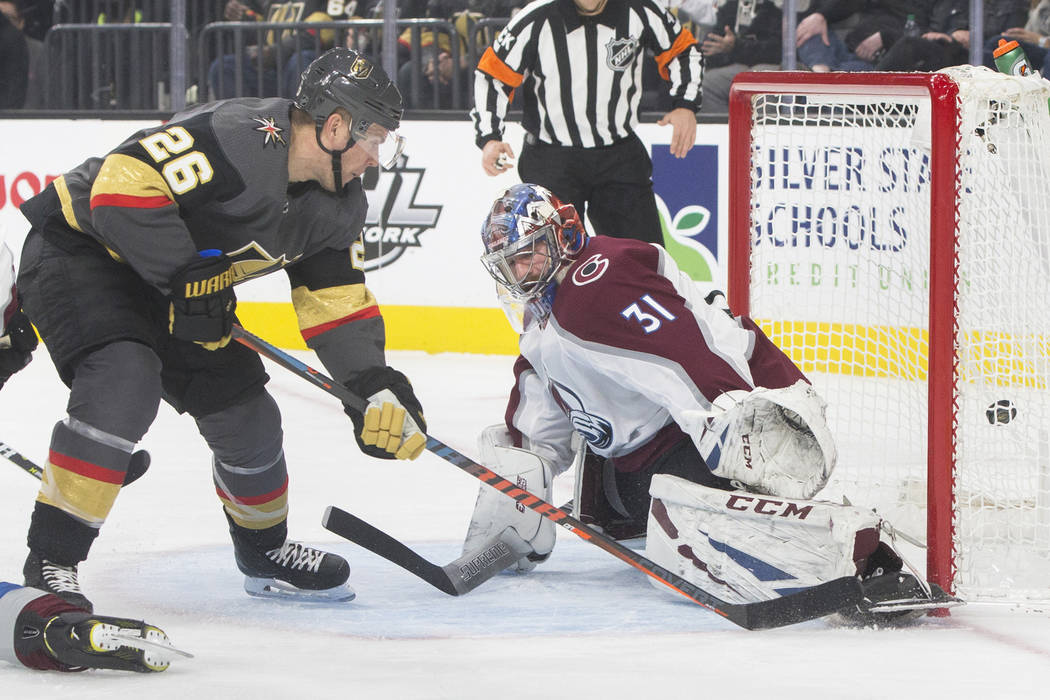 Golden Knights center Paul Stastny (26) scores a first period goal past Colorado Avalanche goaltender Philipp Grubauer (31) on Wednesday, Dec. 27, 2018, at T-Mobile Arena, in Las Vegas. Benjamin H ...