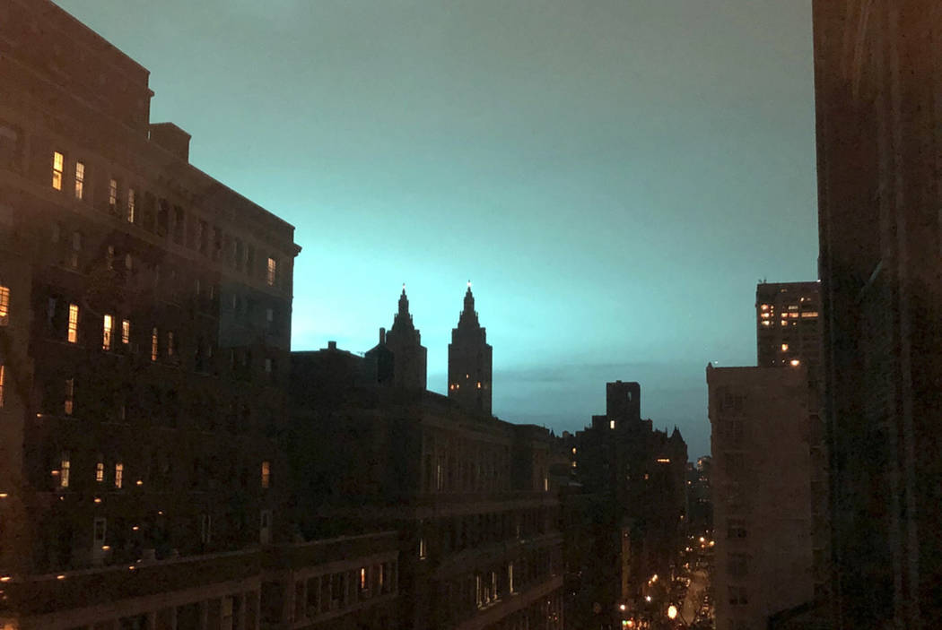 This photo shows blue light over New York, as seen from Manhattan Brough of New York on Thursday, Dec. 27, 2018. New York police said a transformer exploded at a Con Edison facility in Queens on T ...