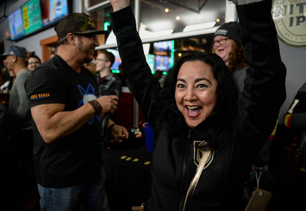 Erica Pangborn cheers after winning a 7Five Brewing Company shirt during a raffle at a party for the release of Ryan Reaves' new beer, Training Day, at PKWY Tavern Flamingo in Las Vegas, Thursday, ...