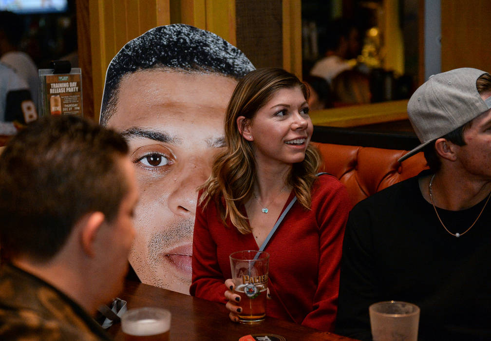Cheyenne Cook sits next to a Ryan Reaves cutout at a party for the release of Reaves' new beer, Training Day, at PKWY Tavern Flamingo in Las Vegas, Thursday, Dec. 27, 2018. Caroline Brehman/Las Ve ...