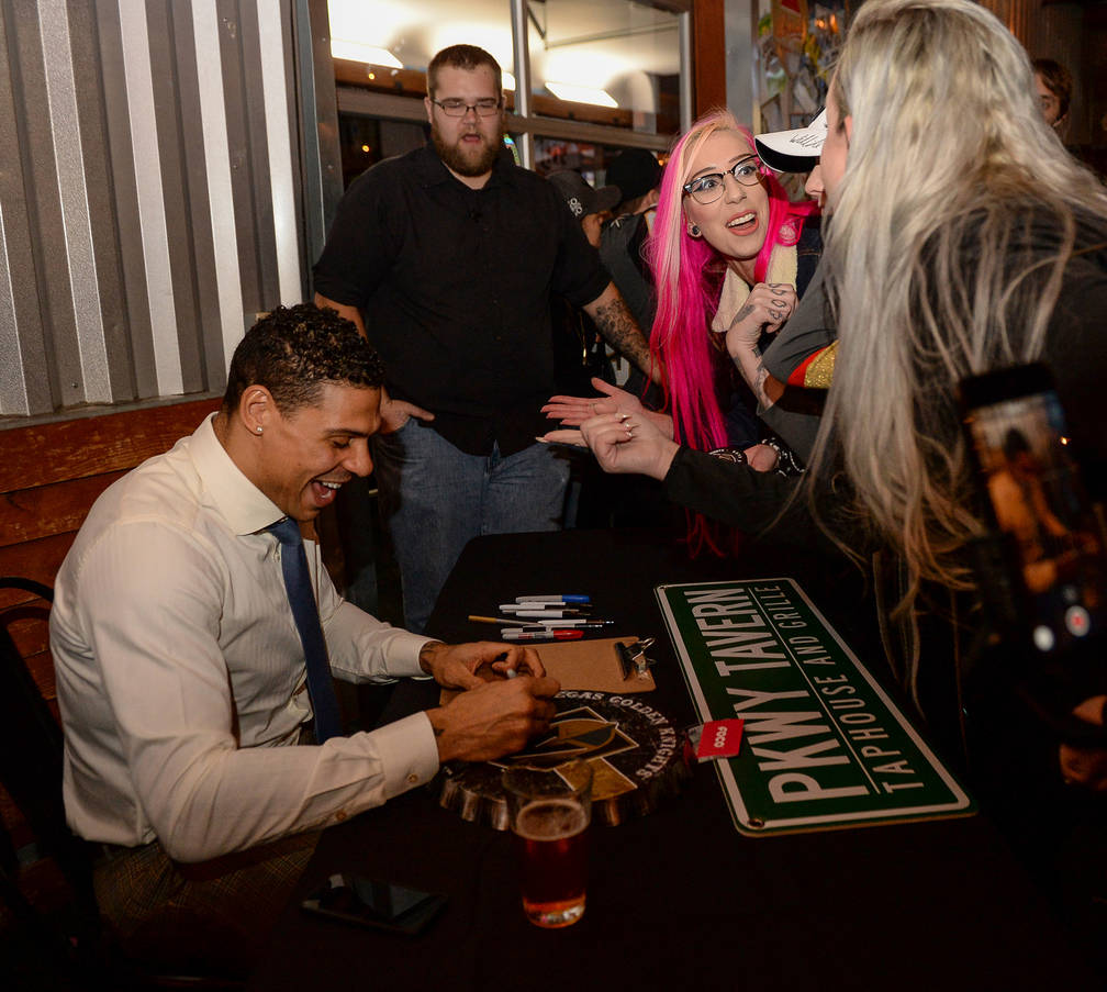 Golden Knights player Ryan Reaves signs memorabilia for fans at a party for the release of Ryan Reaves' new beer, Training Day, at PKWY Tavern Flamingo in Las Vegas, Thursday, Dec. 27, 2018. Carol ...