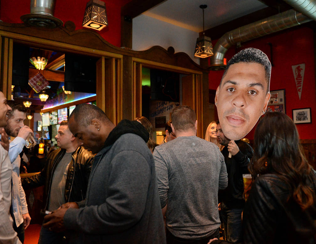 Cutouts of Ryan Reaves are carried by people gather at a party for the release of his new beer, Training Day, at PKWY Tavern Flamingo in Las Vegas, Thursday, Dec. 27, 2018. Caroline Brehman/Las Ve ...