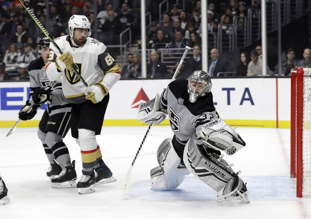 Los Angeles Kings goaltender Jonathan Quick, right, stops a shot next to Vegas Golden Knights' Alex Tuch during the first period of an NHL hockey game Saturday, Dec. 29, 2018, in Los Angeles. (AP ...