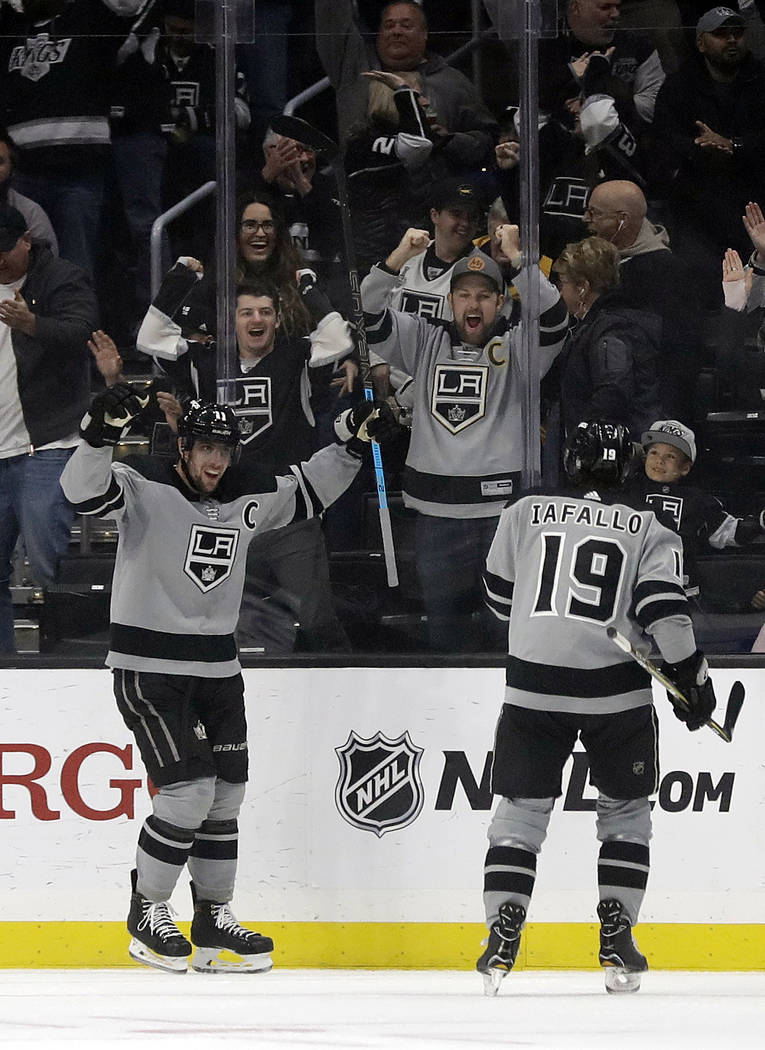 Los Angeles Kings' Anze Kopitar, left, celebrates his goal with teammate Alex Iafallo (19) during the first period of an NHL hockey game against the Vegas Golden Knights Saturday, Dec. 29, 2018, i ...