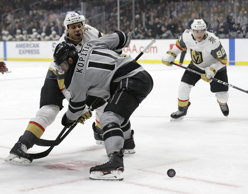Vegas Golden Knights' Ryan Reaves, left, faces off against Los Angeles Kings' Anze Kopitar during the first period of an NHL hockey game Saturday, Dec. 29, 2018, in Los Angeles. (AP Photo/Marcio J ...