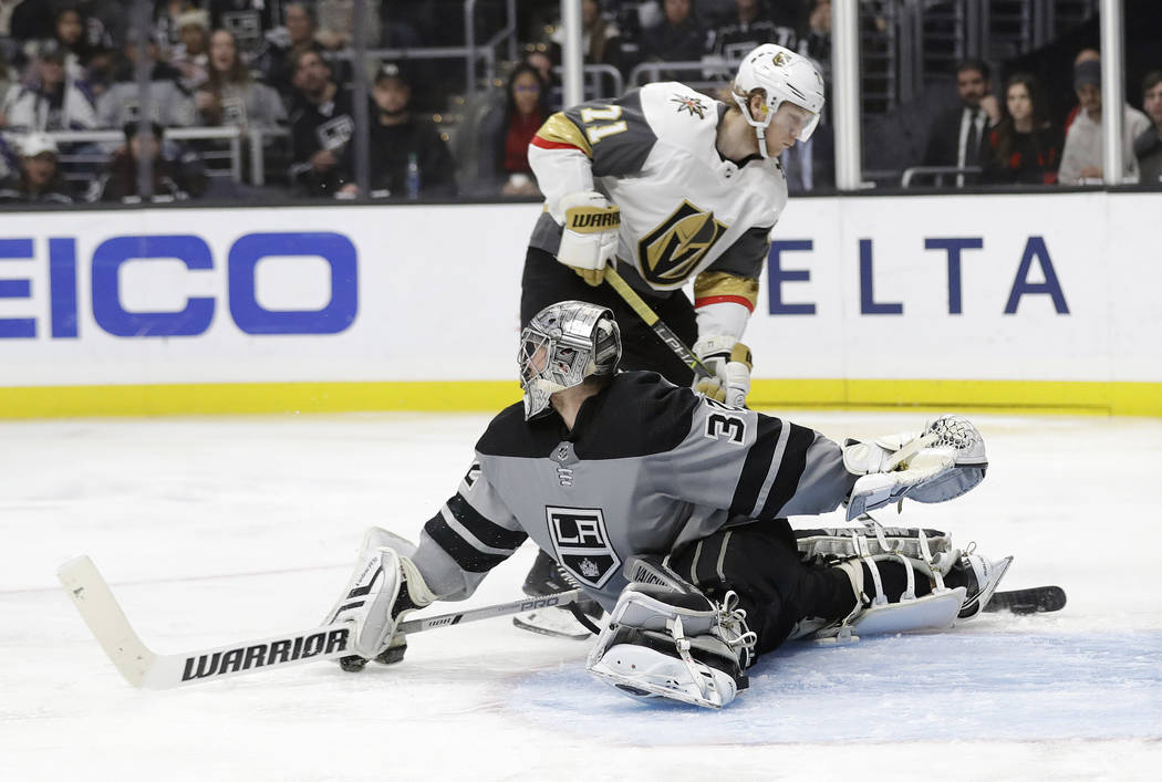 Vegas Golden Knights' William Karlsson, top, scores past Los Angeles Kings goaltender Jonathan Quick during the third period of an NHL hockey game Saturday, Dec. 29, 2018, in Los Angeles. (AP Phot ...