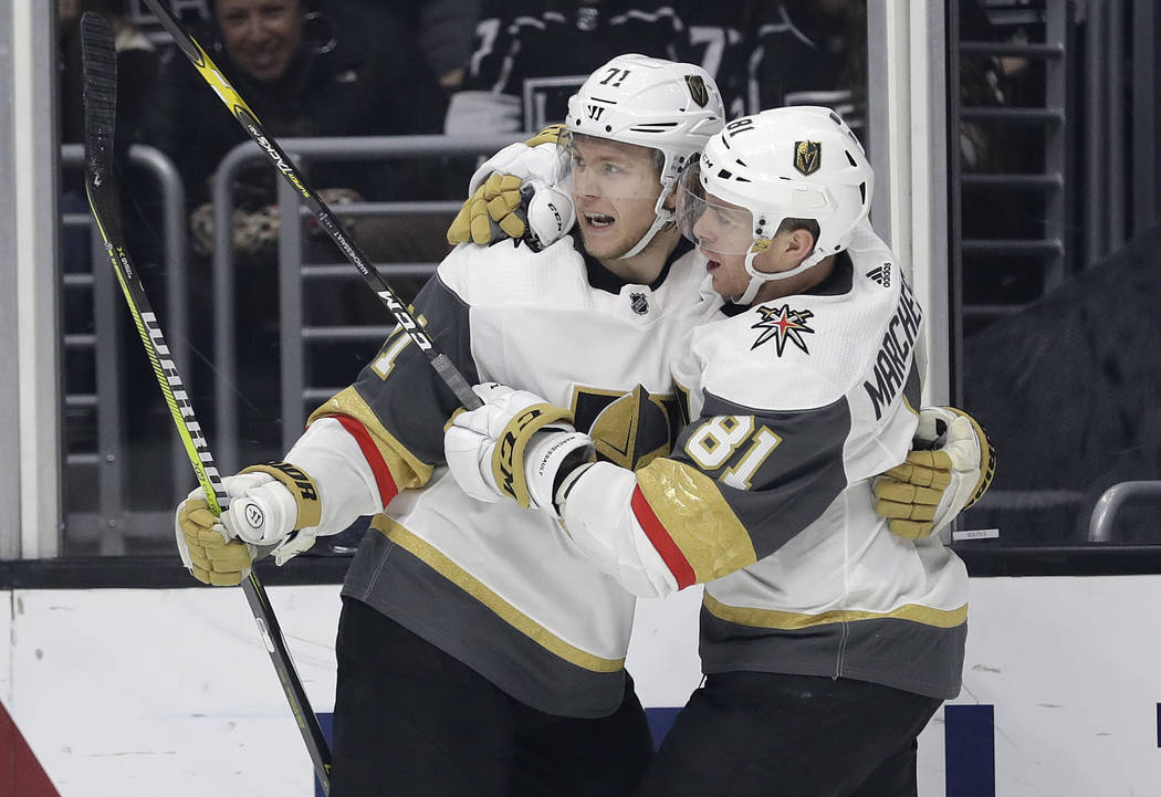 Vegas Golden Knights' William Karlsson, left, celebrates his goal with teammate Jonathan Marchessault during the third period of an NHL hockey game against the Los Angeles Kings on Saturday, Dec. ...
