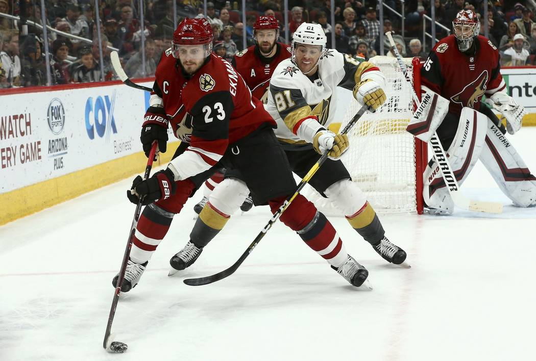 Arizona Coyotes defenseman Oliver Ekman-Larsson (23) tries to keep the puck away from Vegas Golden Knights center Jonathan Marchessault (81) as Coyotes center Derek Stepan, second from left, and C ...