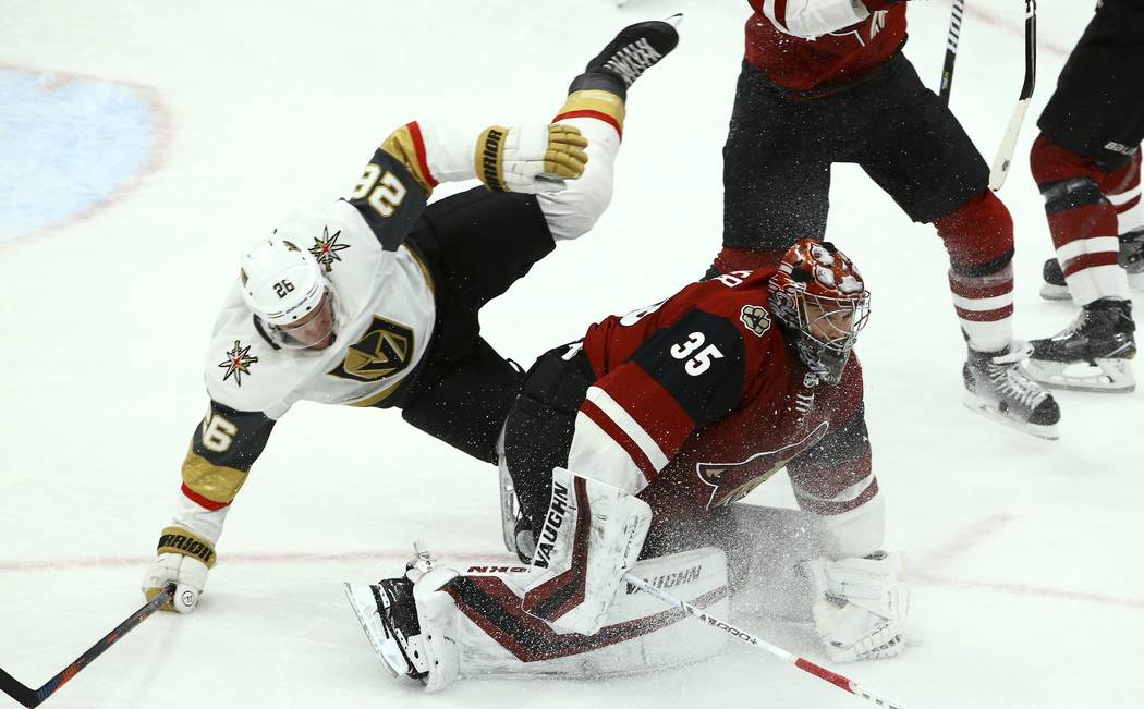 Vegas Golden Knights center Paul Stastny (26) collides with Arizona Coyotes goaltender Darcy Kuemper (35) during the third period of an NHL hockey game Sunday, Dec. 30, 2018, in Glendale, Ariz. Th ...