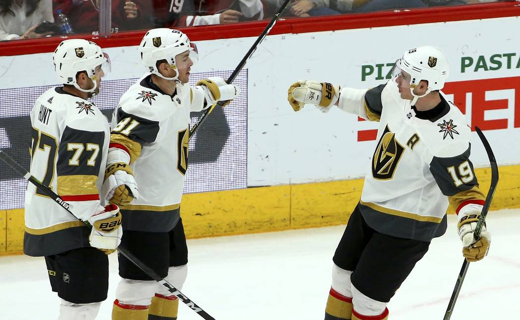 Vegas Golden Knights right wing Reilly Smith (19) celebrates his goal against the Arizona Coyotes with center Jonathan Marchessault (81) and defenseman Brad Hunt (77) during the second period of a ...