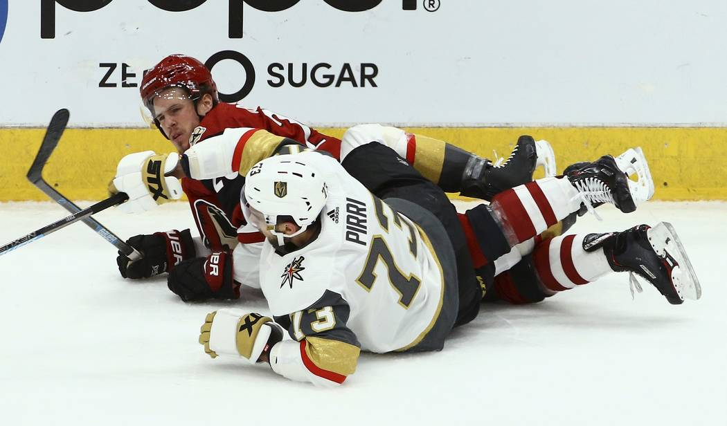 Vegas Golden Knights center Brandon Pirri (73) upends Arizona Coyotes center Nick Cousins, left, during the third period of an NHL hockey game Sunday, Dec. 30, 2018, in Glendale, Ariz. The Golden ...