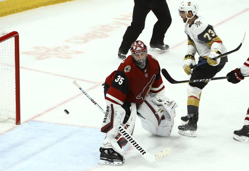 Vegas Golden Knights center Brandon Pirri (73) scores a goal against Arizona Coyotes goaltender Darcy Kuemper (35) during the third period of an NHL hockey game Sunday, Dec. 30, 2018, in Glendale, ...