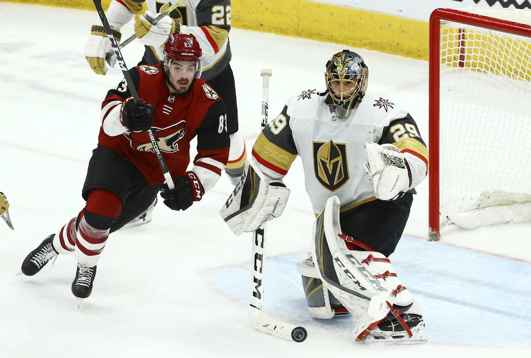 Vegas Golden Knights goaltender Marc-Andre Fleury (29) makes a save on a shot by Arizona Coyotes right wing Conor Garland (83) during the third period of an NHL hockey game Sunday, Dec. 30, 2018, ...