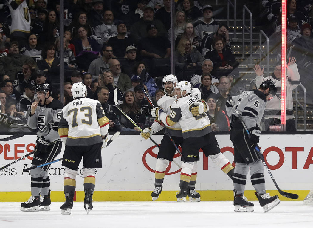 Vegas Golden Knights' Alex Tuch, center, celebrates his goal with teammate Paul Stastny (26) during the second period of an NHL hockey game against the Los Angeles Kings Saturday, Dec. 29, 2018, i ...