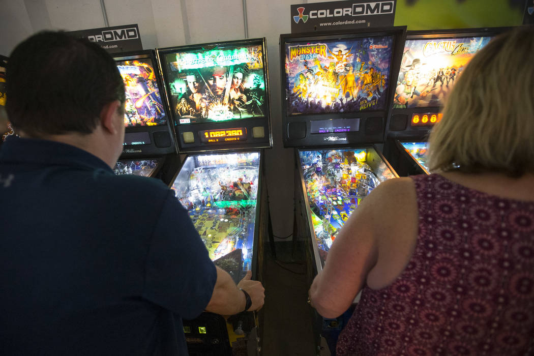 Patrons play pinball machines during a visit to the Pinball Hall of Fame located at 1610 E. Tropicana Avenue in Las Vegas on Saturday, July 28, 2018. Richard Brian Las Vegas Review-Journal @vegasp ...