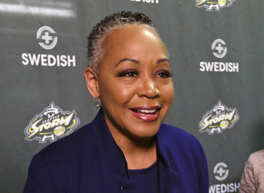 In this June 13, 2017, file photo, WNBA president Lisa Borders talks with the media in Seattle. As 2018 comes to a close, the WNBA is at a crossroads. (AP Photo/Elaine Thompson, File)