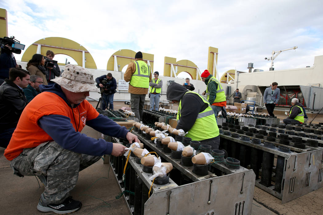 Technicians with Fireworks by Grucci, including Matthew Alberts, left, load pyrotechnics on the roof of Planet Hollywood in Las Vegas Friday, Dec. 27, 2018. More than 80,000 pyrotechnic effects wi ...