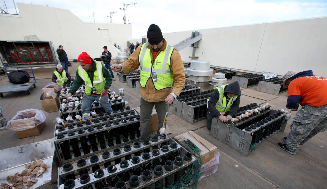 Technicians with Fireworks by Grucci load pyrotechnics on the roof of Planet Hollywood in Las Vegas Friday, Dec. 27, 2018. More than 80,000 pyrotechnic effects will light up the sky over the Strip ...