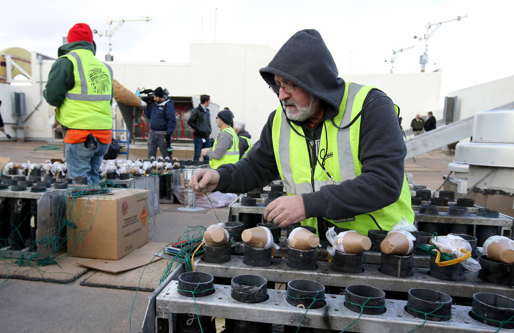 Technicians with Fireworks by Grucci, including Jim Giordano, right, load pyrotechnics on the roof of Planet Hollywood in Las Vegas Friday, Dec. 27, 2018. More than 80,000 pyrotechnic effects will ...