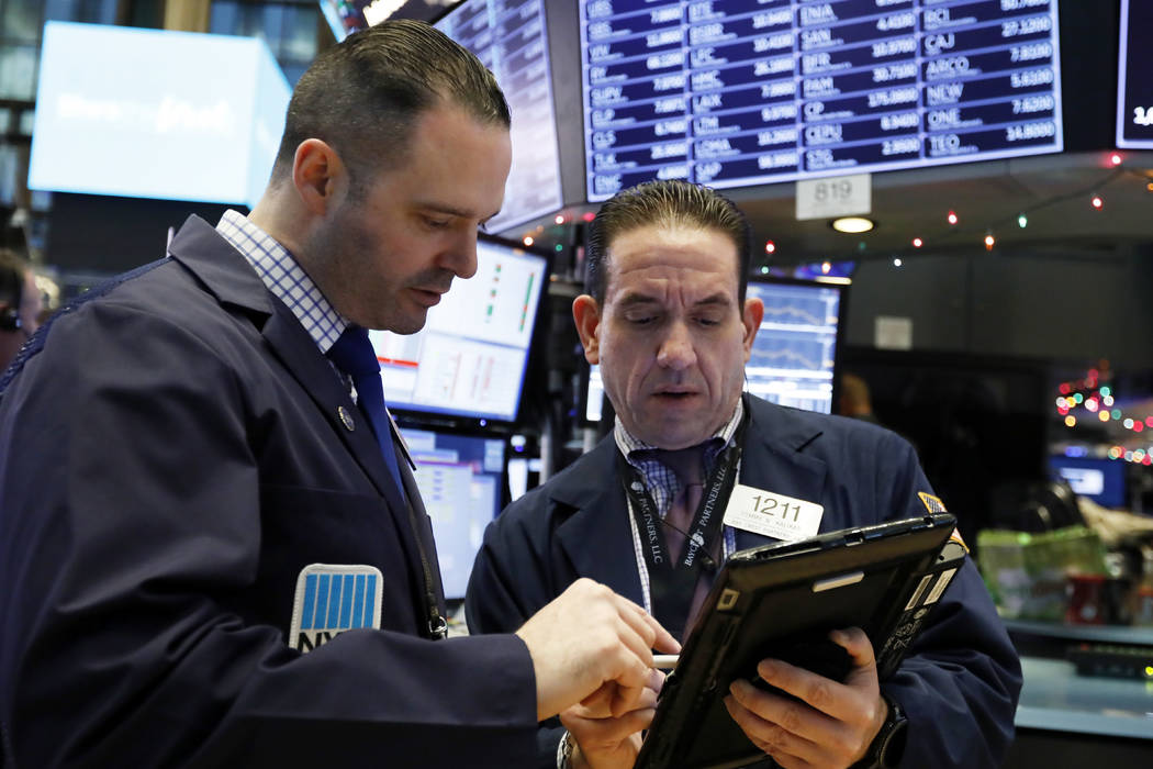 Executive Floor Governor Charles Caccese, left, and trader Tommy Kalikas consult on the floor of the New York Stock Exchange, Friday, Dec. 28, 2018. Stocks are opening higher Friday as U.S. market ...
