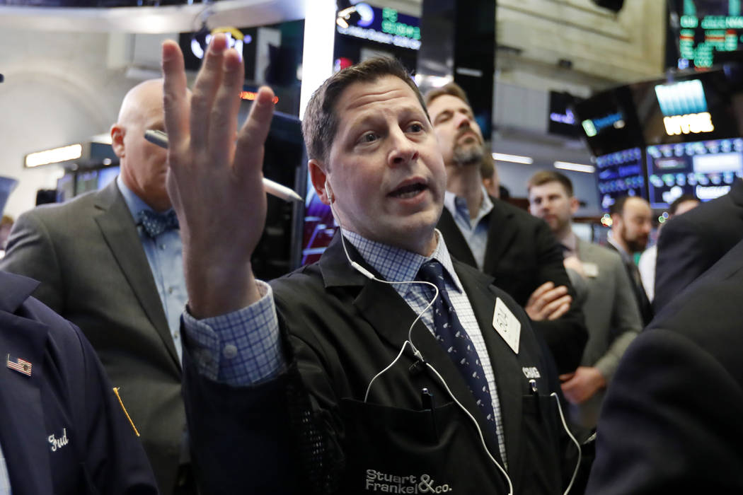 Trader Craig Esposito works on the floor of the New York Stock Exchange, Friday, Dec. 28, 2018. Stocks are opening higher Friday as U.S. markets try to maintain the momentum from a late-day rally ...