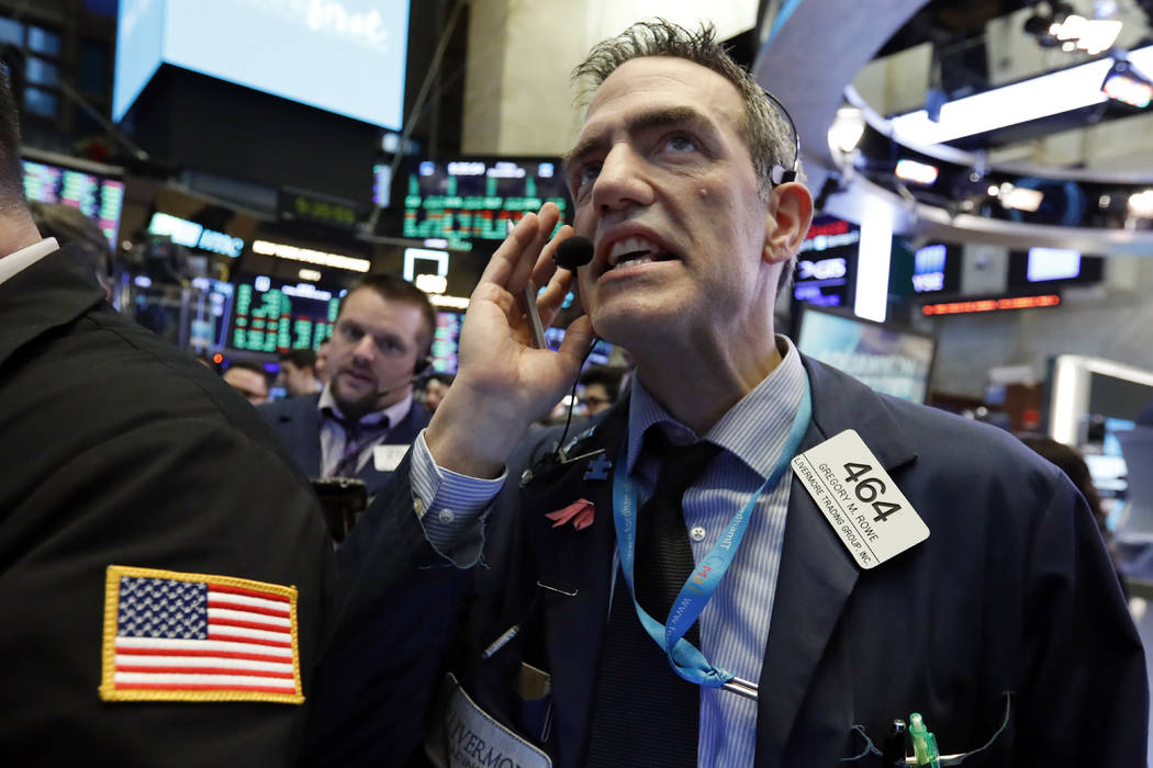 Trader Gregory Rowe works on the floor of the New York Stock Exchange, Friday, Dec. 28, 2018. Stocks are opening higher Friday as U.S. markets try to maintain the momentum from a late-day rally on ...