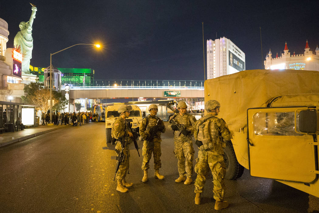 Members of the National Guard keeps watch near the New York-New York hotel-casino on New Year's Eve, Sunday, Dec. 31, 2017. (Richard Brian/Las Vegas Review-Journal) @vegasphotograph