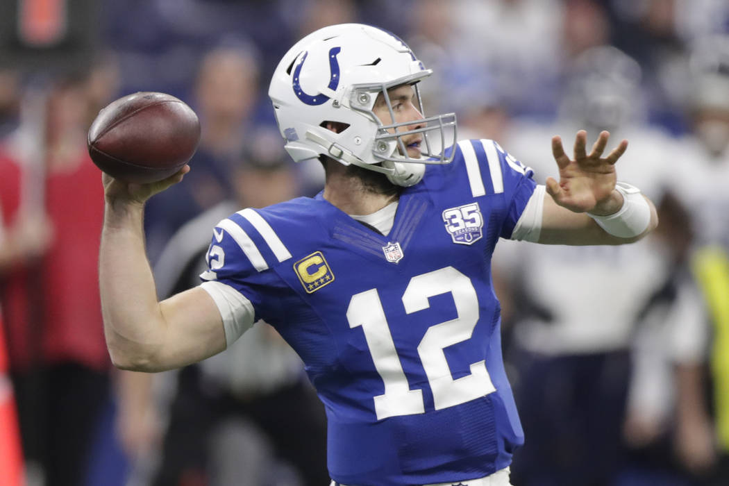 Indianapolis Colts quarterback Andrew Luck (12) throws during the first half of an NFL football game against the Tennessee Titans, Sunday, Nov. 18, 2018, in Indianapolis. (AP Photo/Michael Conroy)