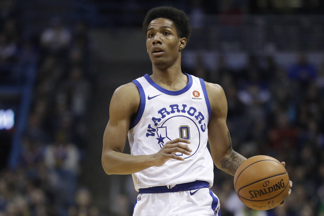 Golden State Warriors' Patrick McCaw dribbles during the first half of an NBA basketball game against the Milwaukee Bucks Friday, Jan. 12, 2018, in Milwaukee. (AP Photo/Morry Gash)