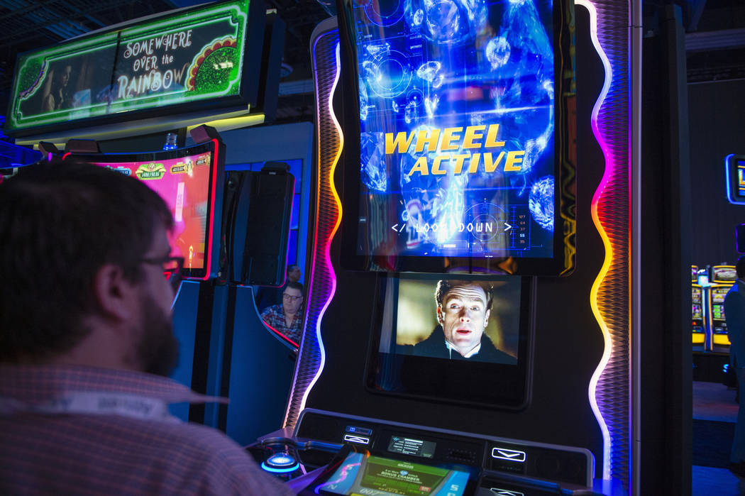 Scientific Games unveils its DIE ANOTHER DAY game that uses an illusion technique called Pepper's ghost to create a visual experience for the user at the 18th annual Global Gaming Expo at Sands Ex ...